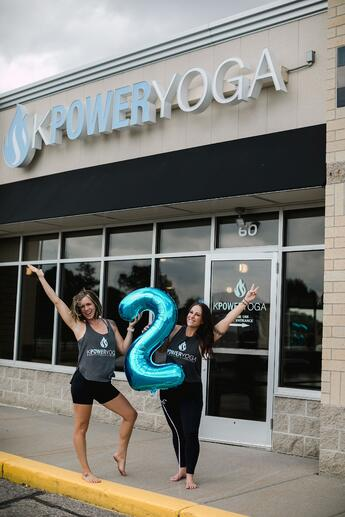 Kelsey and her partner meghan in front of KPower Yoga