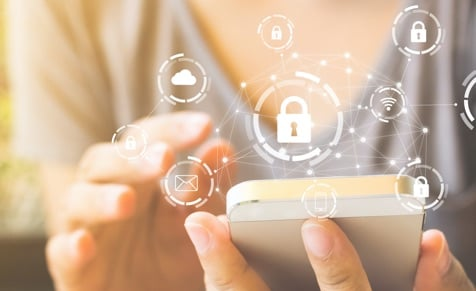 woman using smart phone with security graphic overlay
