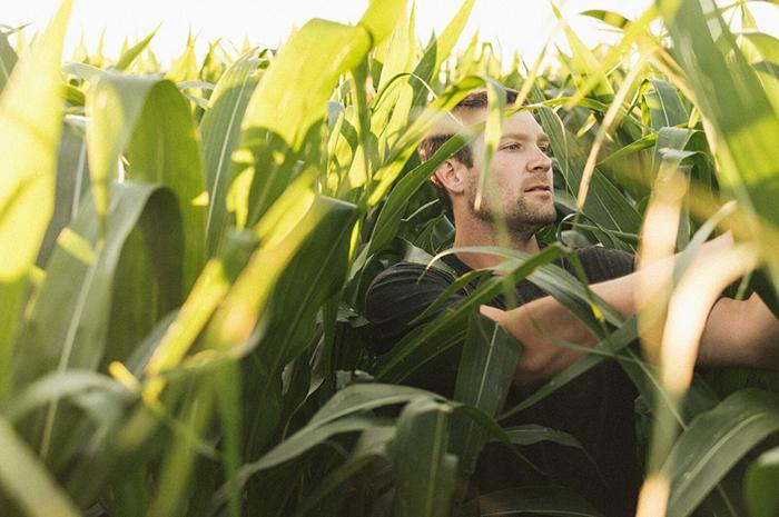 Zach Johnson in corn field